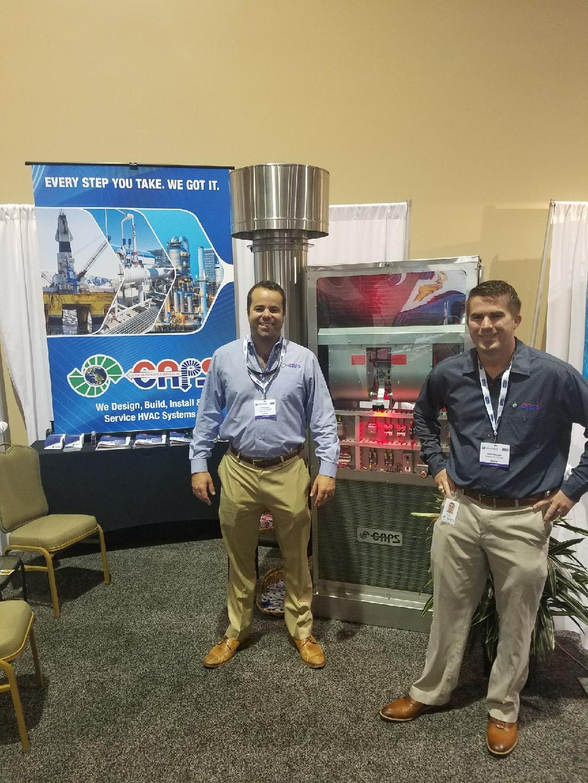 Carl & Matt in front of a 2 ton wall mount HVAC unit
